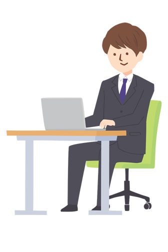businessman sitting at a computer desk
